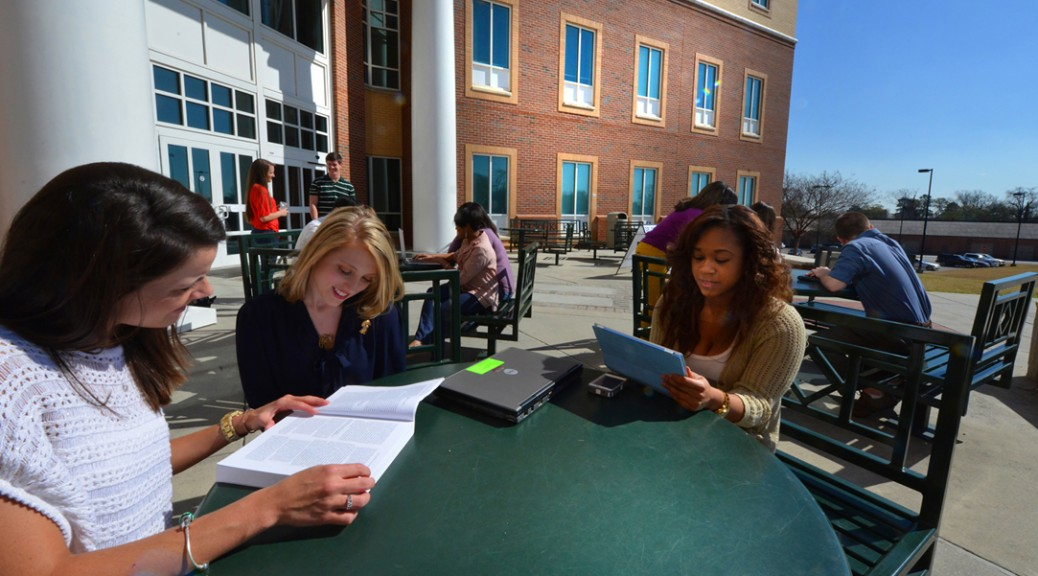 students on campus reading