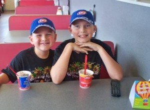 Hunter Piper, right, enjoys a Blizzard at DQ on Miracle Treat Day in 2010.